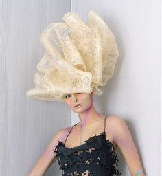 A long blonde straight sculptured quirky avant garde hairstyle by Hooker & Young