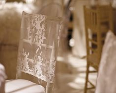 Lace chair cap turns a classic chivari chair into a delicate custom look. Tres Chic!