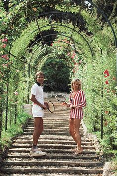 Jack and GeeGee Entz beneath the rose-canopied steps which lead to the entrance of the tennis courts at the Villa d'Este at Tivoli, near Rome, Italy, circa Photo Slim Aarons Slim Aarons, Marcello Mastroianni, Bcbg, Old Money, Thing 1, High Society, Attractive People, Mode Vintage, Vintage Italy
