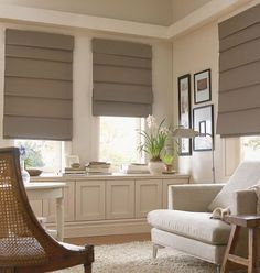 Hobbled roman shades have more structure, retain the horizontal element even when they're down. It's a choice.