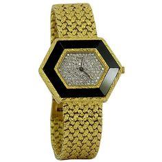 Piaget Lady's Yellow Gold, Onyx and Diamond Hexagonal Bracelet Watch. Circa 1970s
