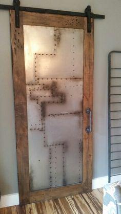 Steam punk scrap metal door on sliding barn door track