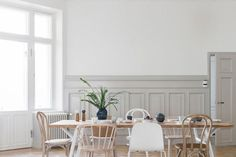A simple grey and white dining area in a magnificent Finnish apartment / Bo LKV & Marja Wickman.
