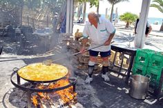 At Nerja, on Spain's Costa del Sol, there's a lunchtime seaside feast every day at Ayo's bar, where paella over an open fire. Ayo's is famous for its beachside all-you-can-eat paella feast at lunchtime at Burriana Beach. Paella fires get stoked up at about noon. Grab one of a 100 tables under the canopy next to the open-fire cooking zone, & enjoy the beach setting w a jug of sangria