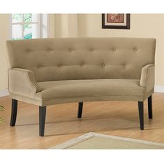 Add a modern style to your home with this Hilton curved loveseat. The fun curve of this loveseat and styled arms give a modern feel. The espresso finished legs and button-tufted upholstery provide a classic look to this light brown chair.