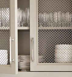 Relaxed and Refined Stainless steel mesh cabinet faces show off dishware. - Kitchens: Relaxed and Refined - Traditional Home®Stainless steel mesh cabinet faces show off dishware. - Kitchens: Relaxed and Refined - Traditional Home® Refacing Kitchen Cabinets, Cabinet Refacing, Kitchen Cabinetry, Kitchen Redo, Kitchen Remodel, Kitchen Design, Cabinet Ideas, Kitchen Ideas, Kitchen Pantry