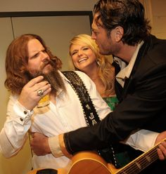 The look on Jamey Johnson's face is the same one I get when I hear Blake Shelton on the radio! I bet he's wondering how that jass ack got a record deal too! ;)