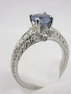 Sapphire Ring with Flower Motif....love the antique style!