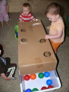 Infant & Toddler Fun: Balls, Bells, a Basket, and a Box What a terrific idea for a box! This simple game will keep young toddlers busy for a long time! Thanks to Dot to Dot Childcare for this. Toddler Play, Baby Play, Toddler Crafts, Crafts For Kids, Infant Toddler Classroom, Infant Play, Toddler Busy Bags, Toddler Stuff, Infant Activities