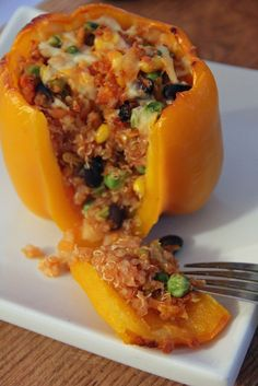 quinoa stuffed peppers (gluten-free, vegetarian, & vegan) HUGE SUCCESS. I added zucchini as well. And half rotel half tomato sauce.