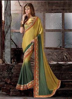 Grab the second look in this elegant attire for this season. This mustard and green silk and georgette designer saree is accenting the gorgeous feeling. The embroidered, patch border and resham work o...