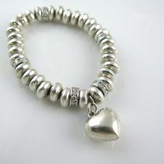 Diamond Tennis Bracelet Resetting custom made by The Perfect Setting