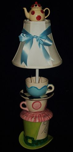 Alice In Wonderland Mad Hatter Tea Party Lamp. $135.00, via Etsy.      want to make something like this for Emmas new room
