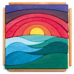 This carefully handcrafted wooden puzzle from Grimm's Spiel & Holz of Germany features a sunrise of red, orange, yellow, and purple rising above the landscape.