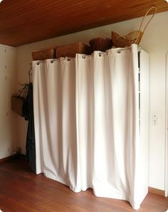 Use An Bookcase Tension Rod With A Curtain To Hide The