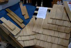 Pose d'une toiture en bardeaux de bois - MaisonEco - Construction maison écologique