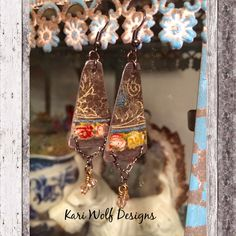 A personal favorite from my Etsy shop https://www.etsy.com/listing/263989169/repurposed-tin-earrings-shabby-chic