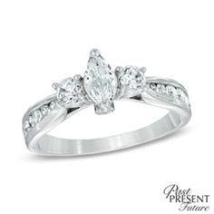 """Win her heart with a diamond engagement ring that honors your past, celebrates your present, and looks forward to a future together. Fashioned in 14K white gold, this ring showcases a 1/3 ct. marquise-cut diamond center stone flanked by two round accent diamonds. Additional diamonds are channel-set into the ring's shank, completing the design. Radiant with 1 ct. t.w. of diamonds, this ring is finished with a polished shine. Two shimmering diamond accents and the hallmark """"Past, Present…"""