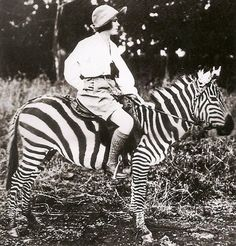 Osa Johnson on a zebra in Kenya, ca 1930, from  Women Travelers: A Century of Trailblazing Adventures, 1850–1950 by Alexandra Lapierre via Amy Azzarito, designsponge