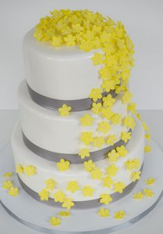 Yellow Flower Wedding Cake This is another version of my original yellow cascading flower wedding cake. Flowers are gumpaste and the ribbon...