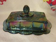 Blue carnival 1/4lb covered butter dish in the Harvest, Grape Leaf pattern. Indiana Glass Company