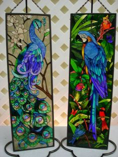 Maxwell's Unique Gifts and Home Decor:    JB22 Peacock:  A stately blue and green peacock perched upon a magnolia branch.  Shades of blue, green, purple and white on a beige background.  5 x 16    JB2 Blue Macaw:  A beautiful blue and yellow macaw perched in a tropical rainforest setting accented with other brightly colored birds.  Bright blues, greens, reds and yellow accent this beautiful tropical bird  5 x 16