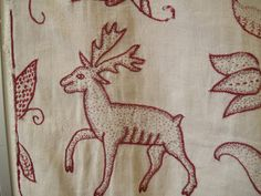 Crewel work deer worked in stem stitch and seeding. Dated 1620, English.