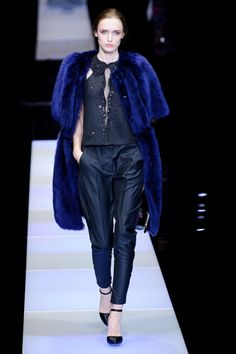 Evening here was less red carpet and more city-fied. Colored furs topped shantung tux pants and beaded halters with swirling patterns or ruched ribboning.    - HarpersBAZAAR.com