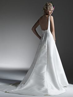 Sottero and Midgley - Mccall // This luxe Mikado fabric creates this dramatic, structured A-line wedding dress with sophisticated bateau neckline, scene-stealing sheer panel inset at side seams, hidden pockets, and stunning open back. The most elegant of modern minimalism.
