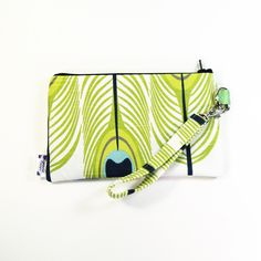 This clutch/wristlet is made with 2 really cute fabrics. A zipper pulls it all together, literally. And it has a cute coordinating wrist strap that clips onto t