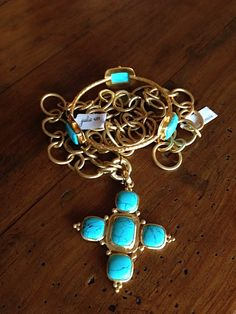 Harpeth Gallery Walton Estes of Harpeth Gallery has a keen eye when it comes to selecting gorgeous jewelry. Her selection is highly curated with only a select number of jewelers featured. This gorgeous aqua chalcedony forms a mosaic-like cross pendant on long classic chain in 24 karat quadruple plate gold. Julie Vos is the designer.