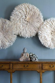 Juju (feather) hats from Cameroon make for beautiful wall art