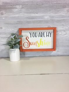 You Are My Sunshine  Details: - Finished Size: Approximately 13.5wide x 9tall - Frame: Orange Milk Paint - Background Color: Antique White Milk Paint - Lettering: Milk Painted Soft Gray, Orange and Yellow  Add this wood wall sign to any room to add a pop of color to your walls. Its sure to put a smile on your face. Great option for a baby shower or new baby gift. We use 100% quality pine that may include visible knots, grains, and/or small cracks. We feel these imperfections add characte...
