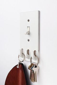 Well duh. Why didn't I think of this earlier? Light switch hooks - PERFECT for near the door