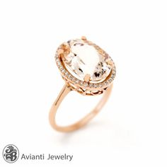 """This gorgeous Morganite is surrounded with thirty six round diamonds. The Morganite is set on 14 karat rose gold. The perfect ring for an engagement. This elegant ring is from our """"Blushing Rose"""" collection. Morganite Engagement Rings, Morganite Engagement Ring, Diamond Halo Engagement Ring, Morganite Ring, 5 Carat Morganite Ring 