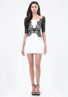 Stunning party dress in curve-sculpting jersey. Chic lace overlay forms an off-shoulder design. Elbow sleeves. Back hook-and-eye and exposed zip closure. Partially lined.