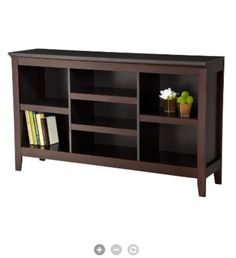 Entertainment center that goes under the wall-mounted television. Target.