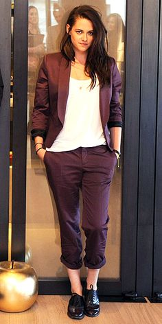 Kristen Stewart in a a burgundy Chaiken blazer and pants, plus a delicate pendant, BaubleBar bracelet and lace-ups.