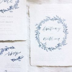 LITCHFIELD SUITE  The Litchfield Suite offers a beautiful dusty blue watercolor foliage design around the names on the invitation. Delicate calligraphy pairs perfectly with the soft watercolor foliage to give it a lovely and elegant feel.