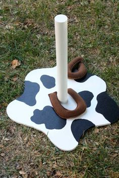 Piece of wood, painted, PVC pipe and horseshoes made out of felt. Simple and cute!