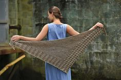 This fun-to-knit, two-color shawl is worked from one point, increasing outward. The body of the shawl is worked in a combination of garter stitch stripes and a mosaic pattern. The stripes and mosaic pattern are worked all in one row. Mosaic knitting is a great way to achieve colorwork without having to carry two yarns at a time; instead, slipped stitches create the colorwork pattern. The shawl ends with a border of the slipped stitch pattern.