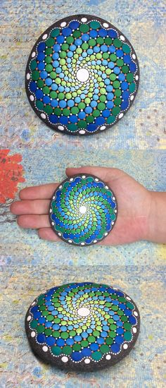 "Mandala Stone (Large) by Kimberly Vallee: Hand painted with acrylic and protected with a matt finish, this ""large"" stone is a touch larger than my usual stones, at a little over 3"" diameter. It is one-of-a-kind."
