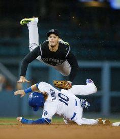 96ef50a777b Turning two - Colorado Rockies third baseman Nolan Arenado gets airborne  over Los Angeles Dodgers  Justin Turner