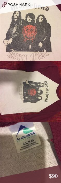 Amazing True Vintage Motörhead Baseball Tee Paper thin white base with maroon 3/4 sleeves and neck binding, faded front graphic. Rounded bottom raw hem. Vintage size M. Slight pilling throughout. White center is thinned and heathered with age. Back is blank. Pit to pit measures 19 inches, length is 27. This is a true vintage piece and has been worn and laundered. Excellent vintage condition for its age. Unisex Vintage Tops Tees - Long Sleeve