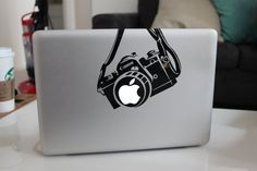 Etsy listing at http://www.etsy.com/listing/127597020/canon-camera-funny-decal-sticker-for