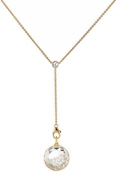 """Handcrafted in Manhattan, Renee Lewis' 18k yellow gold Y-chain necklace features a removable faceted rock quartz crystal pendant. The circular pendant is detailed at one side with a domed, rose-cut surface and filled at the other side with a white diamond """"shake."""" Handmade. """"Shake"""" consists of loose multi-shaped white diamonds. Bezel-set rose-cut white diamond charm at intersection of Y-chain. Removable pendant secures with lobster clasp. White diamon"""