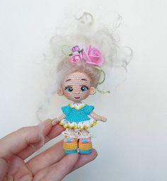 Tiny crochet doll.