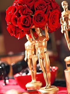 DIY Oscar themed centrepieces using an artist's dummy and lots of golden spray paint.
