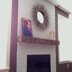 Modern white brick fireplace with vintage reclaimed wood mantle update complete!