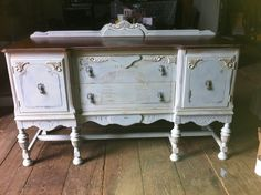 This sideboard had so much potential.  The Louis Blue and Paris Grey mix worked out so well with the wood top.  A thin wash of Old Ochre warmed it up.  Small touches of french gilding wax gave a nice touch along with the script on the front.